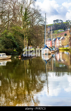 Yachts moored in the River Dart in Totes, Devon right by the old wharf which is now apartments. - Stock Photo