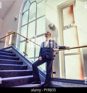 Swansea, Wales, Uk, May 1988: Manager of the Swansea Grand Theatre poses on the stairs of the foyer. Shot on medium format film. - Stock Photo