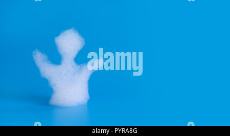 Soapy bubbles foam man silhouette on blue background. Suds shower texture macro view photo, shallow depth of field. Copy space. - Stock Photo