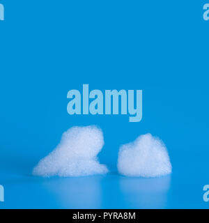 Soap bubbles foam on blue background. Suds shower texture macro view photo, shallow depth of field. Copy space. - Stock Photo