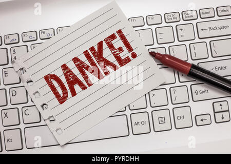 Text sign showing Danke. Conceptual photo used as informal way of saying thank you in German language Thanking. - Stock Photo