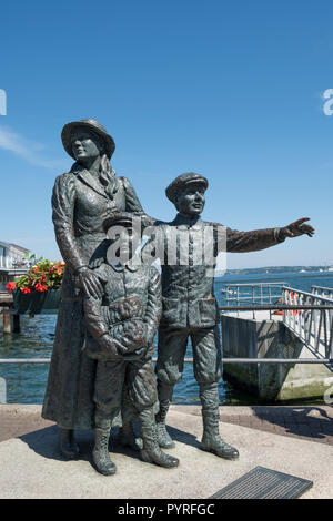 Statue of Annie Moore in Cobh, County Cork, Ireland, with her brothers, first Irish immigrant to the United States in 1892
