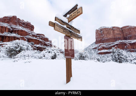 Bell Rock, left, with Courthouse Butte, right, after a snow storm near Sedona, Arizona - Stock Photo