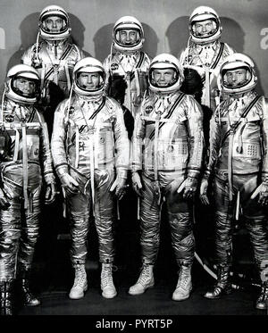 The group portrait of the original seven astronauts for the Mercury Project. NASA selected its first seven astronauts on April 27, 1959. Left to right at front: Walter M. Wally Schirra, Donald K. Deke Slayton, John H. Glenn, Jr., and Scott Carpenter. Left to right at rear: Alan B. Shepard, Virgil I. Gus Grissom, and L. Gordon Cooper, Jr. - Stock Photo