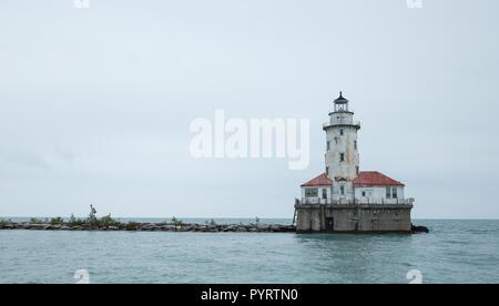 Minimalist photo of the Chicago Harbor Lighthouse on a gloomy day. - Stock Photo
