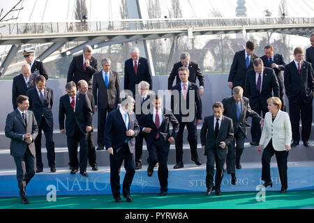 President Barack Obama, NATO Secretary General Jaap de Hoop Scheffer and fellow NATO leaders step down from a photo platform April 4, 2009, following their group photo at the NATO meeting in Strasbourg, France. - Stock Photo