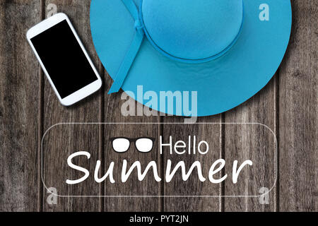 Smartphone and woman hat with text Hello Summer on old wooden table background - Stock Photo