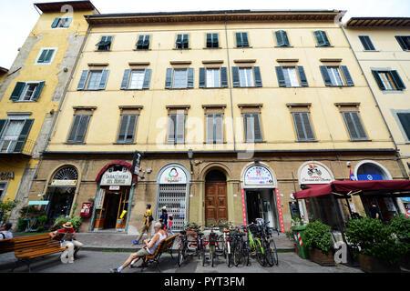 Old buildings along Via Guglielmo Oberdan in Pisa, Italy. - Stock Photo