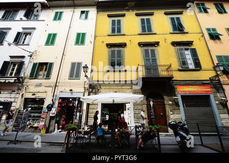Beautiful old buildings along Via Guglielmo Oberdan in Pisa, Italy. - Stock Photo
