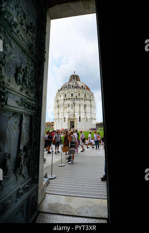The  Baptistery of St. John as seen from the Pisa Cathedral. - Stock Photo