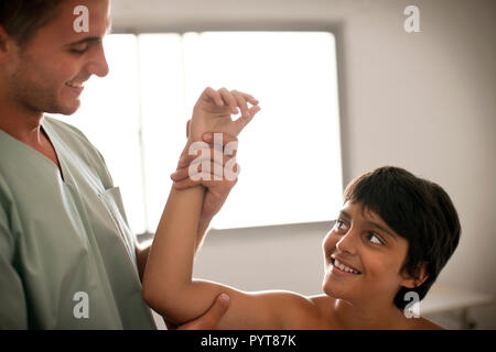 Young girl having a check up at the doctors. - Stock Photo