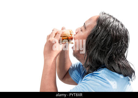 Portrait of asian fat man eating hamburger posing isolated over white background. Fat man diet concept - Stock Photo