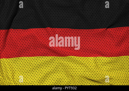 Germany flag printed on a polyester nylon sportswear mesh fabric with some folds - Stock Photo