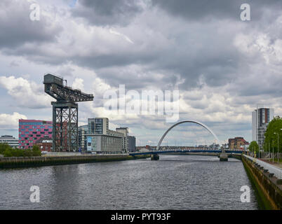 Looking East down the River Clyde towards the Finieston Crane and Squinty Bridge at Pacific Quay, Glasgow, Scotland, UK. - Stock Photo