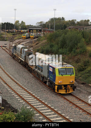 Network rail MPV no DR 98932 leaves the Wigan Spring Branch maintenance depot Tuesday afternoon to perform a Rail Head Treatment service Cw 6409 - Stock Photo