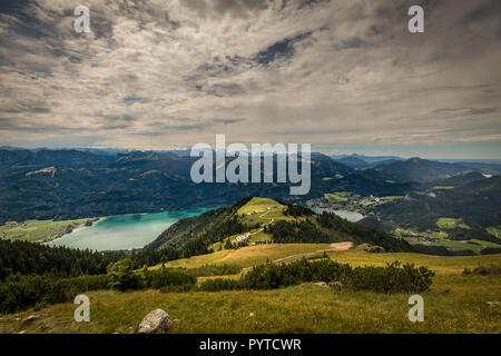 Mountain landscape with hiking trail and view of beautiful landscape over the Wolfgangsee - Stock Photo