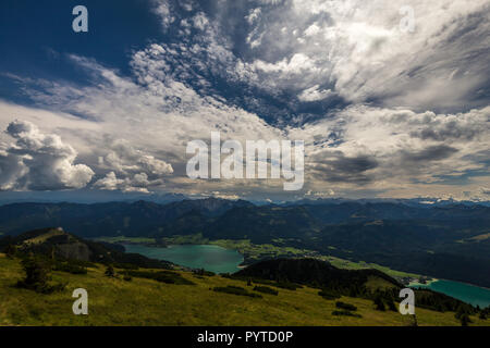 Mountain landscape on the top of the hiking trail to the Schafberg and view of landscape over the Wolfgangsee - Stock Photo