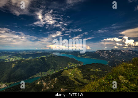 Mountain landscape on the top of the hiking trail to the Schafberg and view of beautiful landscape over the Attersee lake - Stock Photo