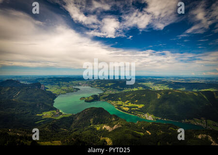Mountain landscape on the top of the hiking trail to the Schafberg and view of landscape over Mondsee - Stock Photo