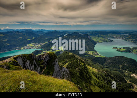 Mountain landscape on the top of the hiking trail to the Schafberg and view of landscape over the Wolfgangsee and Mondsee - Stock Photo