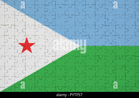 Djibouti flag  is depicted on a folded puzzle - Stock Photo