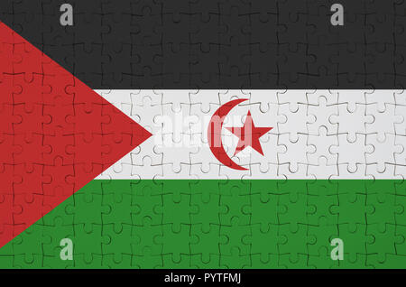Western Sahara flag  is depicted on a folded puzzle - Stock Photo