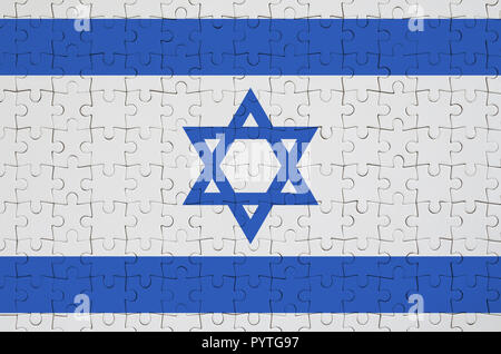 Israel flag  is depicted on a folded puzzle - Stock Photo
