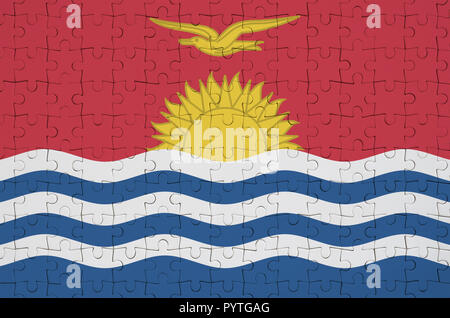 Kiribati flag  is depicted on a folded puzzle - Stock Photo