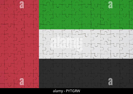 United Arab Emirates flag  is depicted on a folded puzzle - Stock Photo
