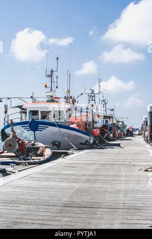 Fishing boats in the harbour of Santa Luzia, Tavira, Portugal - Stock Photo