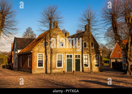 Pitoresque Historic Houses on the Main Square of the Fortified Town Bourtange in the Netherlands - Stock Photo