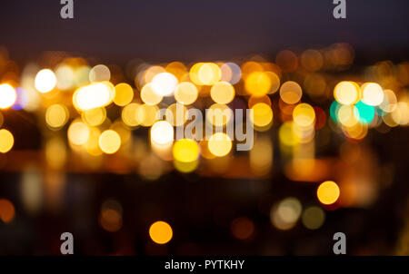 City lights at night. Defocused blur urban buildings bokeh background - Stock Photo