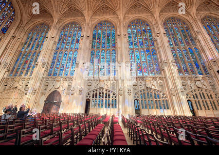 Rows of chairs in front of the north stained glass windows in the ante-chapel of King's college, Cambridge university, England. - Stock Photo