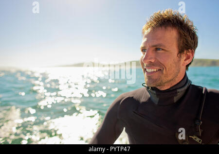 Portrait of a surfer in the water. - Stock Photo