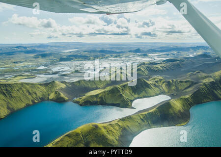 aerial landscape of nature in Iceland, volcanic mountains and lakes in highlands from small airplane - Stock Photo