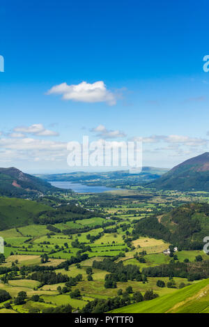 Newlands valley Cumbria, looking north towards the distant Bassenthwaite Lake from the summit of Cat Bells. - Stock Photo