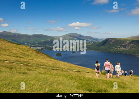 A group of young people walking near the summit of  Cat Bells (451 metres) Keswick, Cumbria, heading towards the shores of Derwent Water. - Stock Photo