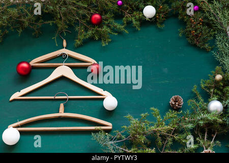 hangers from the wardrobe of clothes on Christmas new year tree - Stock Photo