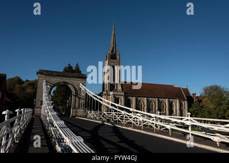 Marlow suspension bridge and All Saints Church at  Marlow in Buckinghamshire, Britain  The Victorian suspension bridge was designed and constructed by - Stock Photo