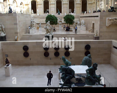 A view of the sculpture garden inside the Louvre art gallery and museum in Paris, France. - Stock Photo