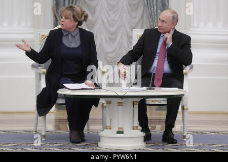 Moscow, Russia. 30th Oct, 2018. MOSCOW, RUSSIA - OCTOBER 30, 2018: Ella Pamfillova (L), chairperson of the Russian Central Election Commission, and Russia's President Vladimir Putin at an event marking the 25th anniversary of Russia's electoral system, at the Moscow Kremlin. Mikhail Metzel/TASS Credit: ITAR-TASS News Agency/Alamy Live News - Stock Photo