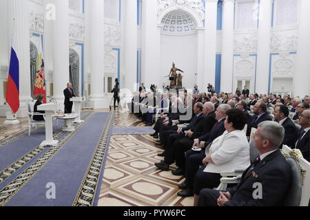 Moscow, Russia. 30th Oct, 2018. MOSCOW, RUSSIA - OCTOBER 30, 2018: Ella Pamfillova, chairperson of the Russian Central Election Commission, and Russia's President Vladimir Putin, from left, at an event marking the 25th anniversary of Russia's electoral system, at the Moscow Kremlin. Mikhail Metzel/TASS Credit: ITAR-TASS News Agency/Alamy Live News - Stock Photo