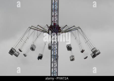 London UK. 30th October 2018. People enjoy a ride on a Fairground flying swings on London Southbank on a cold overcast day with low temperatures Credit: amer ghazzal/Alamy Live News - Stock Photo