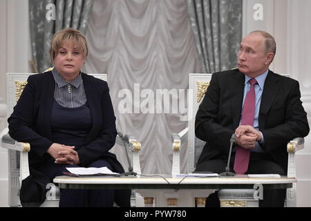 Moscow, Russia. 30th Oct, 2018. MOSCOW, RUSSIA - OCTOBER 30, 2018: Ella Pamfillova, chairperson of the Russian Central Election Commission, and Russia's President Vladimir Putin, from left, at an event marking the 25th anniversary of Russia's electoral system, at the Moscow Kremlin. Alexei Nikolsky/Russian Presidential Press and Information Office/TASS Credit: ITAR-TASS News Agency/Alamy Live News - Stock Photo