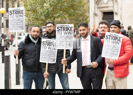 London, UK. 30th October 2018. Uber appeals against a ruling that its drivers have employment rights such as pay and holidays, before the Court of Appeal in the Royal Courts of Justice. The legal case began in October 2016 by Uber drivers James Farrar and Yaseen Aslam (pictured middle) winning before an Employment Tribunal. They are represented by employment solicitor Paul Jennings of Bates Wells Braithwaite. Credit: Joe Kuis / Alamy Live News - Stock Photo