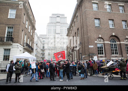 London, UK. 30th October, 2018. Members and supporters of the Independent Workers of Great Britain (IWGB) trade union march together with other precarious workers from the offices of Transport for London to the University of London via the Court of Appeal in support of Uber drivers who are seeking employment rights. The Court of Appeal will today hear an appeal by Uber against a ruling that its drivers are employees rather than self-employed workers. Credit: Mark Kerrison/Alamy Live News - Stock Photo