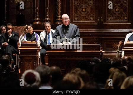 New York, New York, USA. 30th Oct, 2018. Cardinal Timothy Dolan speaking at the interfaith prayer vigil for the shooting at the Tree of Life Synagogue in Pittsburgh, Pennsylvania (October 27) at the Central Synagogue in New York City. Credit: SOPA Images Limited/Alamy Live News - Stock Photo