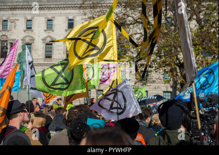 Parliament Square, London, UK. 31 October, 2018. Extinction Rebellion, a new pressure group, is calling for civil disobedience in the UK in November to draw attention to the climate change emergency facing the planet. They call a Declaration of Rebellion at Parliament Square on 31 October 2018. Credit: Malcolm Park/Alamy Live News. - Stock Photo