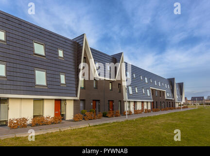 Modern design row houses in a newly developed  family residential area. - Stock Photo