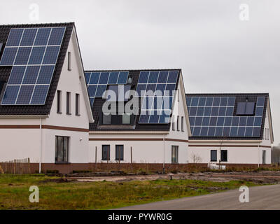Solar Panels installed on Newly Constructed Houses in a Suburban Area - Stock Photo